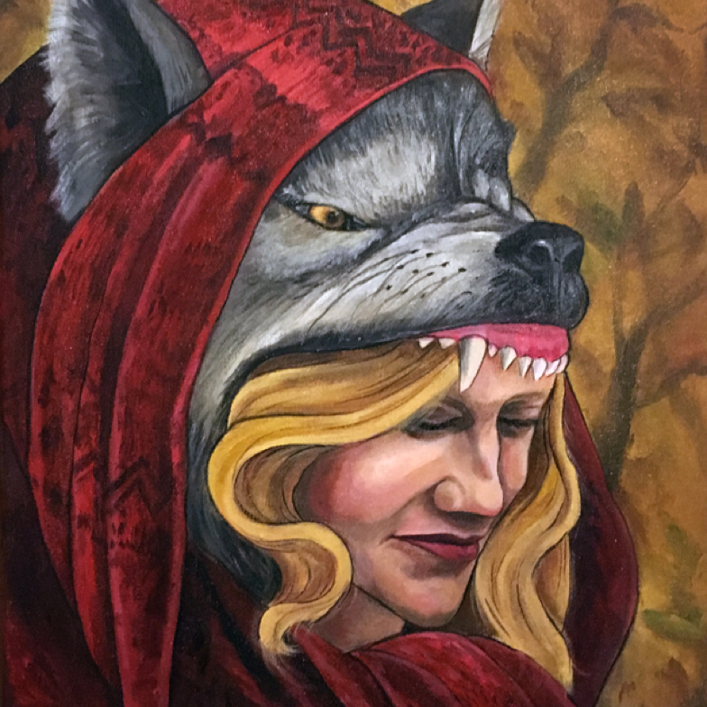 portrait of a young woman wearing a wolfs head and red scarf against an autumn forest backdrop