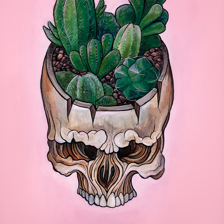 graphical skull with assorted cacti planted inside the upper half of the skull set against a pale pink background
